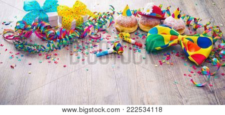 Carnival powdered sugar raised donuts with paper streamers and party bow tie