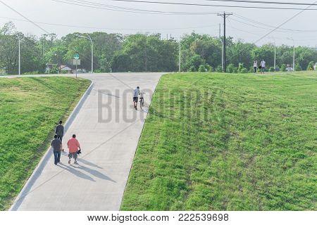 Top View People Walking, Wheeling Bike Up The Dike