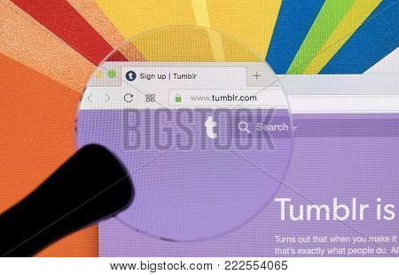Sankt-Petersburg, Russia, January 11, 2018:  Apple iMac with Tumblr homepage on monitor screen under magnifying glass. Homepage of Tumblr.com on PC computer. Tumblr is microblogging and social networking service.
