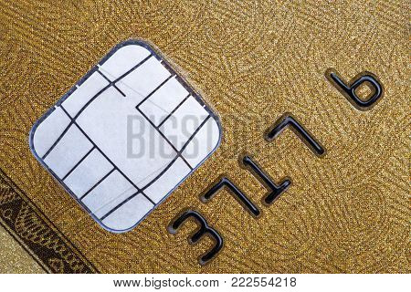 Close-up shot of microchip on golden credit card