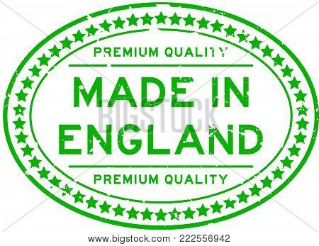 Grunge green premium quality made in England oval rubber seal stamp on white background