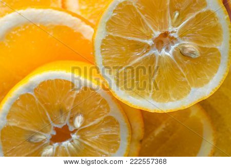 Bright Orange Background From Slices Of Juicy Oranges. Orange Whole.orange Haif. Oranges Slice