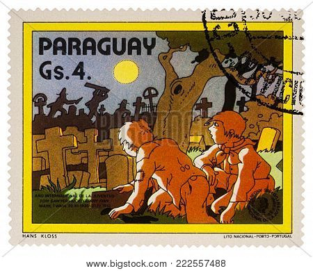 Moscow, Russia - January 18, 2018: A stamp printed in Paraguay shows Tom Sawyer and Huck Finn at the cemetery, Adventures of Tom Sawyer by Mark Twain, series