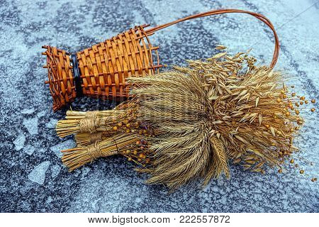 Dry Wheat Bouquet And A Wooden Basket On Ice And Snow