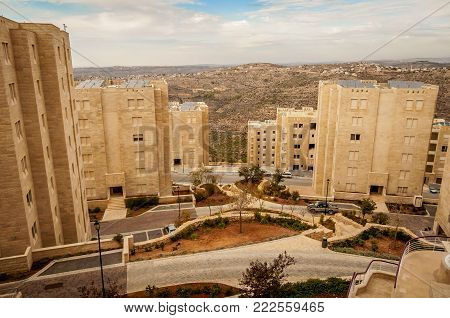 RAWABI, WEST BANK, PALESTINE. November 11, 2017. A view of Samarian hills through the houses of the newly built Palestinian town of Rawabi.