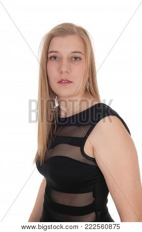 A close up image of a beautiful young woman in a black cocktail dress and long blond hair standing isolated for white background