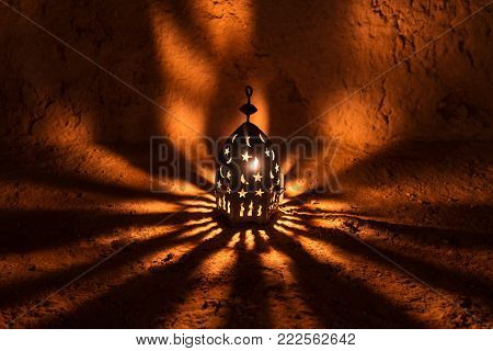 Arabic lamp with beautiful lights in the background. Vintage lantern