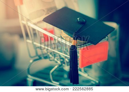 Graduation cap on store shop cart as metaphor for tuition and scholarship choices. Concept of abroad international Educational, Back to School and Studies lead to success.