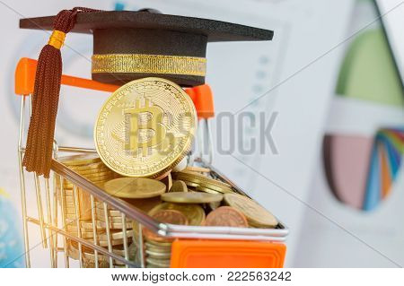 International Graduation cap on Bitcoin Cryptocurrency on Coins shopping cart. Concept of Blockchain Transaction System Crisis, Bitcoin payment buying and for Education certificate of Abroad program