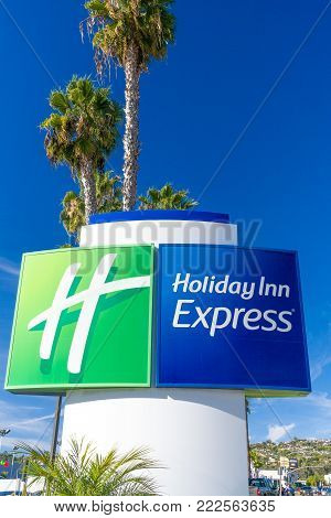 Holiday Inn Express And Suites Sign And Logo