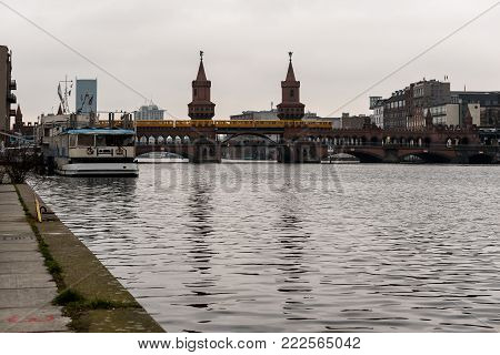 December 16. 2017 Twin towers of the Oberbaumbrucke, a red brick, double-decker rail and road bridge over the river Spree - Kreuzberg, Berlin, Germany