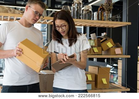 Startup Small Business Owner Working At Workplace. Freelance Man & Woman Seller Check Product Order