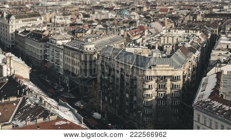 Panorama of houses and streets of Budapest, the facades of the houses and the road with cars in retro style, tilt-shift effect.