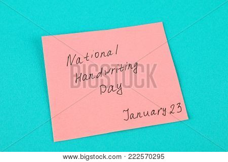 A note with an inscription is a national day of hand writing on a pink background