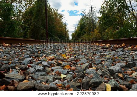 Photo from a train station's rail track when it is empty rails waiting for the road railway rails