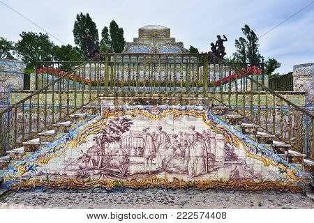 Queluz, Portugal - June 3, 2017: The Tiles Chanel at Queluz National Palace. Tiles panels represent different galant scenes like a hunting, landscape and other