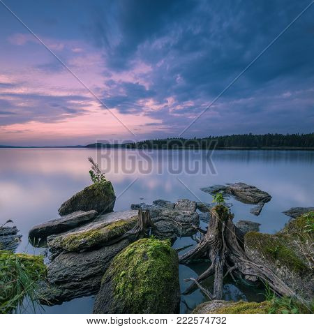 beautiful summer landscape at evening with textured foreground