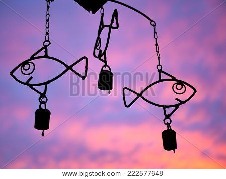 Fish Wind Chime in front of Purple and Orange Sunset