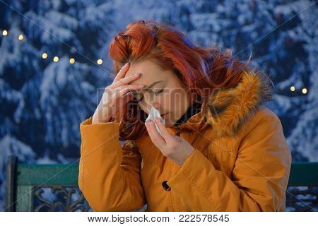 Outdoors portrait of  young woman sick colds,flu,fever outdoor