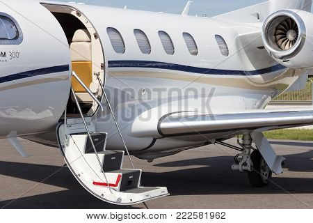 BERLIN, GERMANY - MAY 21: Light business jet Embraer EMB-505 Phenom 300 at the International Aerospace Exhibition ILA on May 21nd, 2014 in Berlin, Germany