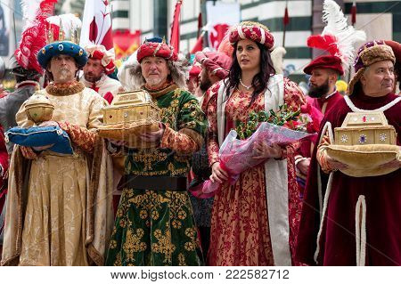 Florence, Tuscany, Italy - January 6, 2018: Three Wise Men and a Florentine noble woman, bringing gifts in precious golden caskets, during the historical recreation of the