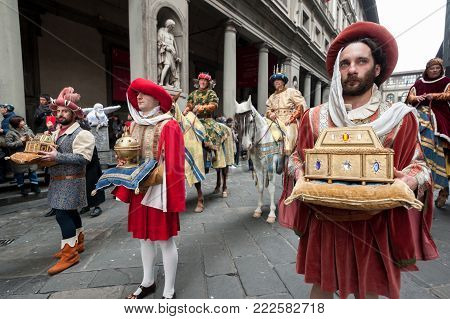 Florence, Tuscany, Italy - January 6, 2018: Three Wise Men on horseback and their servants, in the courtyard of the Uffizi Gallery, bringing gifts during the historical recreation of the