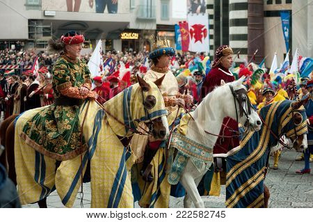 Florence, Tuscany, Italy - January 6, 2018: Three Wise Men on horseback bringing gifts (gold, incense, myrrh) to the new born child Jesus, during the historical recreation of the