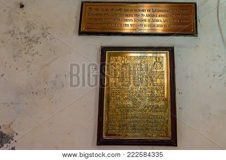 STONE TOWN, ZANZIBAR - JANUARY 9, 2015: Beautiful metal plates with inscriptions in Christ Church Cathedral in Zanzibar. It belongs to the Anglican Church of Tanzania. It is a landmark historical church.