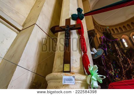 STONE TOWN, ZANZIBAR - JANUARY 9, 2015: Close up wooden crucifiction in Christ Church Cathedral in Zanzibar. It was made out of tree under which Dr.Livingstone died