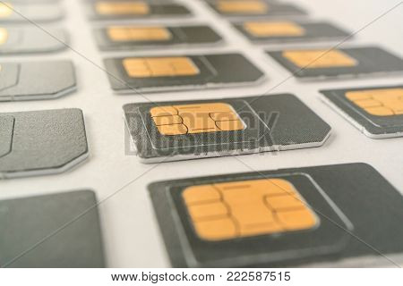 lying in three rows SIM cards, a variety of cards