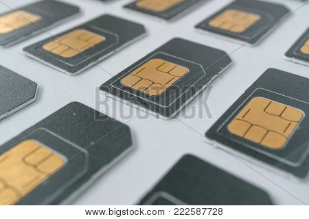 a series of phone SIM cards, grey cards