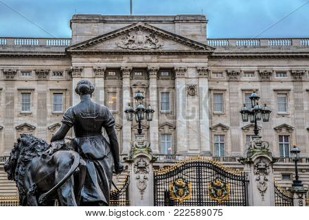 LONDON, UK - NOVEMBER 29, 2017: View of Buckingham Palace and statue part of statuary group Victoria Memorial, ensemble from outside Buckingham Palace.