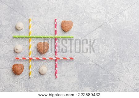 Game TIC TAC toe. Love wins. Saint Valentines Day conception. Top view, flat lay