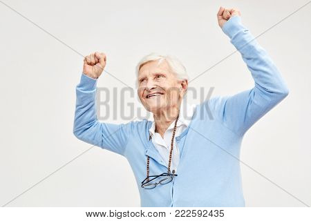 Senior celebrates with clenched fists as a sign of zest for life and vitality
