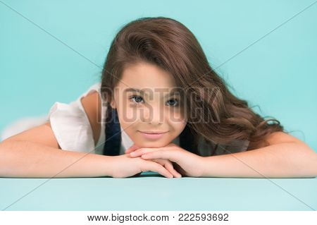 Girl With Smile On Cute Face On Blue Background