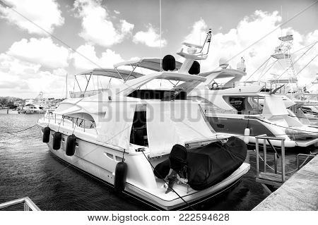 luxury yachts docked in the port in bay at sunny day with clouds on blue sky in La Romana, Dominican Republic