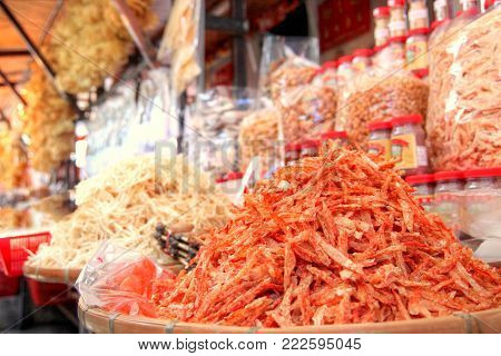 Focus on a pile of dried shrimp among other dehydrated seafood on sale at a store in Tai O, Hong Kong. Dried seafood delicacies are popular Chinese cuisine ingredients, especially during Chinese New Year. poster
