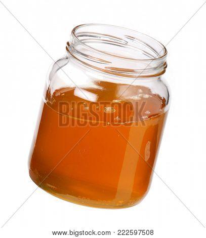 Honey glass pot isolated on white background.