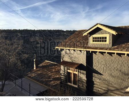 GRAND CANYON NATIONAL PARK, ARIZONA, USA- NOVEMBER 13, 2017: Architecture of a store and view of the beautiful erosion in a sunny day at Grand Canyon National Park