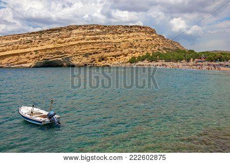 Matala Beach And Ancient Caves On Rocks. Crete Island. Greece.