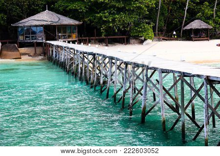 Wooden pier at beach on Tioman Island, Malaysia