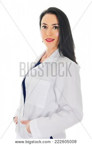 An attractive health care worker looking at the viewer in her lab coat.  On a white background.