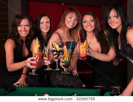 Group of happy girls drinking cocktails