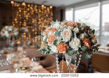 Banquet table in the restaurant, the preparation before the banquet. the work of professional florists