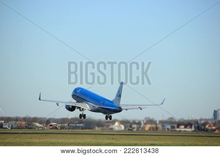 Amsterdam the Netherlands - January 7th 2018: PH-EZY KLM Cityhopper Embraer ERJ-190 takeoff from Polderbaan runway.