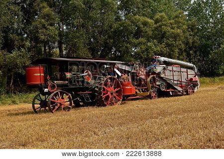 ROLLAG, MINNESOTA, Sept 2, 2017: A Minneapolis Steam Engine and threshing machine are preparing harvest demonstrations at the annual WCSTR farm show in Rollag held each Labor Day weekend where 1000's attend.