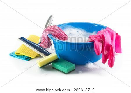Spring cleaning, blue plastic bowl with soap foam and colorful household utensils such as cleaning cloth, sponges and rubber gloves, isolated with shadow on a white background, copy space, selected focus
