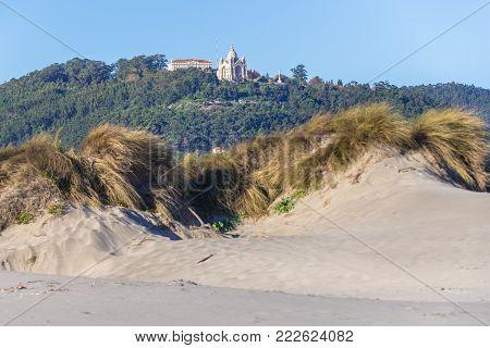 Santa Luzia Basilica, view from Cabedelo Beach over Atlantic Ocean in Viana do Castelo, Portugal
