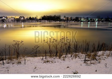 View of Neva River at evening when the clouds reflected the light from the city lights on the outskirts of St. Petersburg, Russia. Long exposure. poster