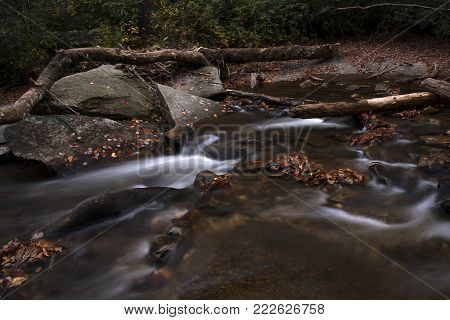 Water flowing in Looking Glass Creek in the Pisgah Forest near Brevard, North Carolina in autumn.